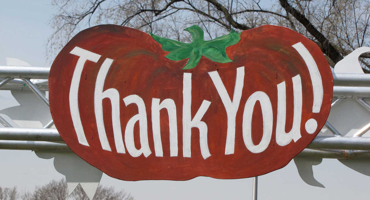 Painted tomato sign that says Thank You!