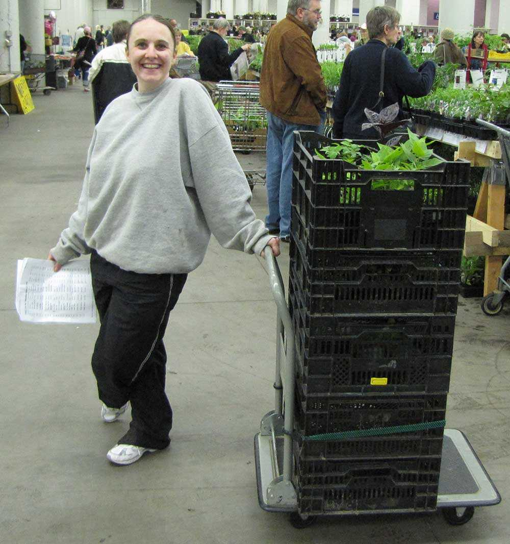 Black plastic crates on an L-shaped cart.