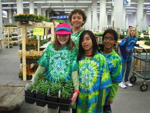 Preteen students with plants, smiling