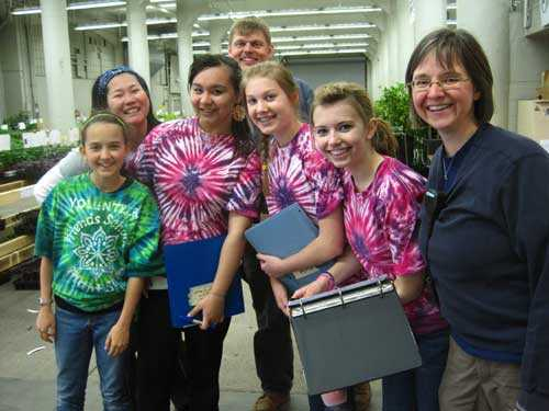 students in colorful tie-dye t-shirts with teacher