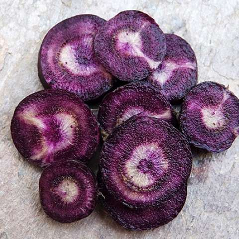Black Nebula carrot slices, purple with a bit of white at the core