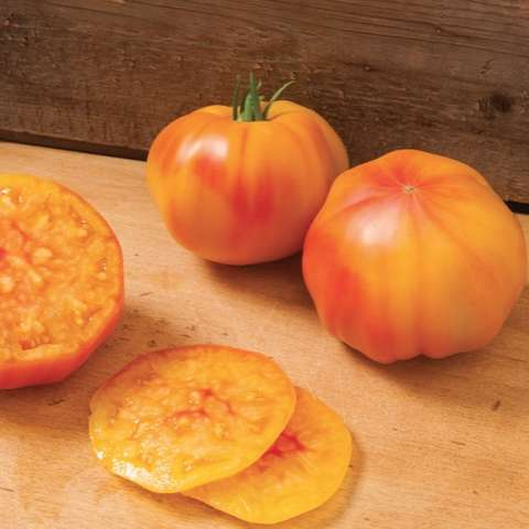 Margold tomato, gold with red stripes and red blush inside